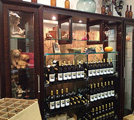 New Tasting Room showing wine bottles and special antiques.